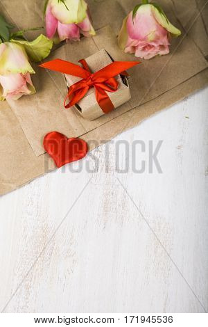Pink Roses,  Gift And Hearts On A Wooden Background.