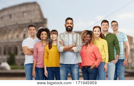 travel, tourism, diversity, ethnicity and people concept - international group of happy smiling men and women over coliseum background