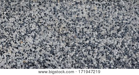washed gravel stone of sand wall texture or sand wall background