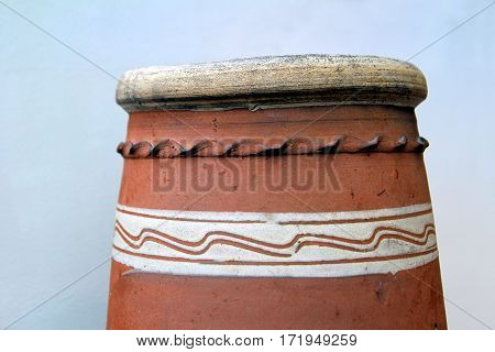 The top of a Fareham Red chimney pot with distinctive white decoration
