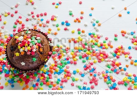 Birthday Chocolate Muffin With Little Colorful Stars On White Background, Top View