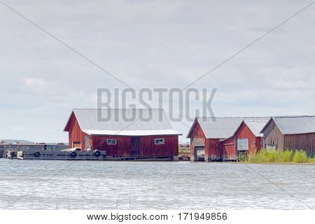 Red boathouses bridge and sea in the archipelago in Aaland Finland