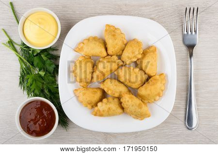 Plate With Chebureks, Bowl With Ketchup And Mayonnaise, Parsley, Dill