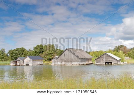 Gray old boathouses reed and sea in the archipelago in Aaland Finland