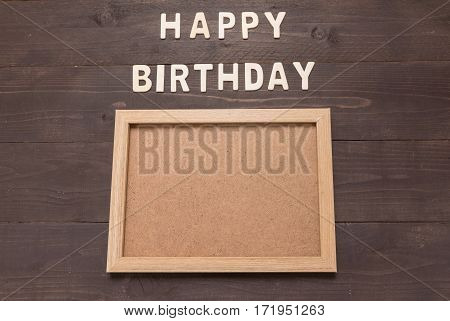 Happy Birthday And Frame Picture On Wooden Background With Copy Space.