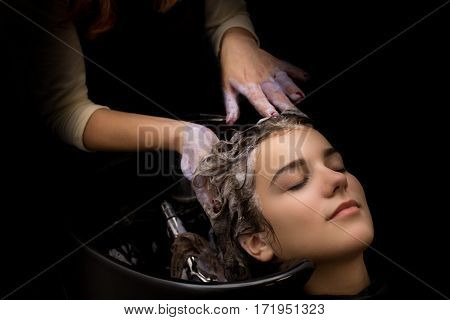 Hairdresser Washing A Clients Hair
