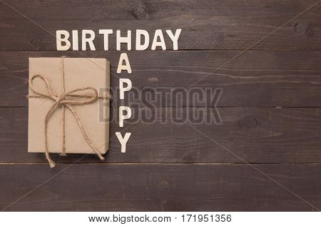 Happy Birthday And Gift Box On Wooden Background With Copy Space