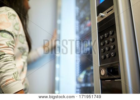 sell, technology and consumption concept - woman at vending machine
