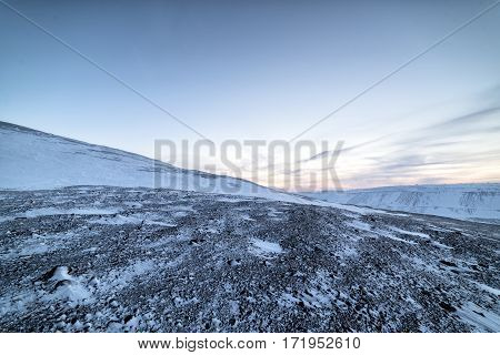Snow-covered hillsides, Arctic mountain desert. Winter decline