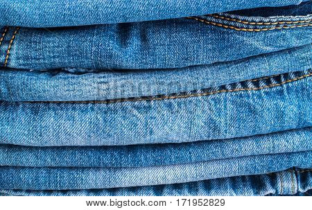 Blue Jeans And Stitches Texture. Denim Background With Seam