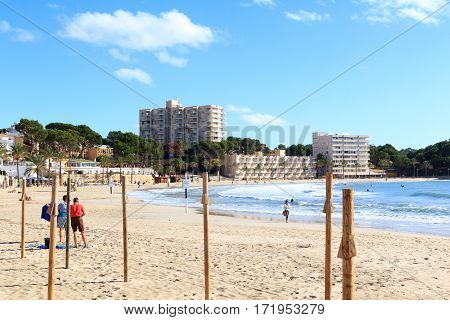 Peguera, Spain - November 6, 2016: Peguera beach panorama with hotels, people and Mediterranean Sea. Peguera is a tourist town on the island of Majorca. It has three large beaches and hundreds of hotels, hostels and apartments.