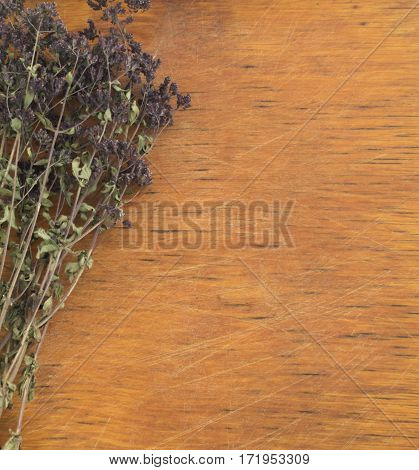 Dried Aromatic Herbs On A Wooden Background