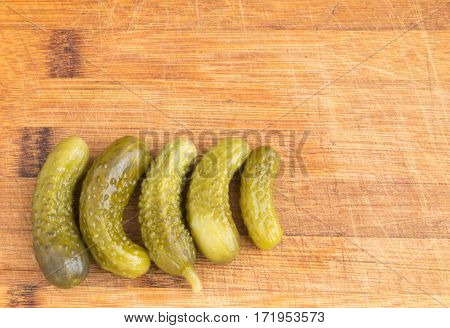 Homemade Pickled Gherkins Or Cucumbers Over Rustic Wooden Background