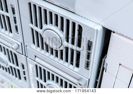 The cooling unit of industrial computer. Electric fan closed shiny metal bars.