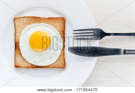fried egg on toast whtie background. studio shot