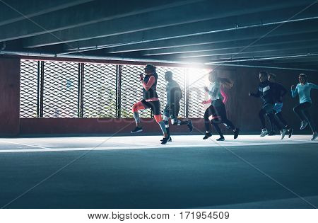 Group Of Runners Exercise Indoors
