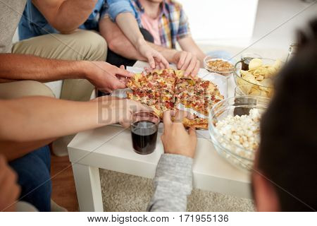 fast food, eating, party and people concept - close up of people taking pizza slices at home