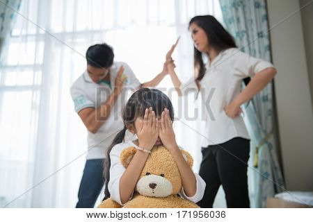 Sad child from this father and mother arguing family negative concept. broken home story.