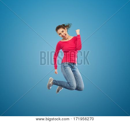 happiness, freedom, motion and people concept - smiling young woman jumping in air over white background