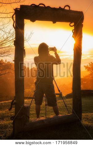 Photographer in frame Morning sunrise over mist with tourist and photographer Huai Nam Dang National Park Chiang Mai Thailand landscape travel and nature concept