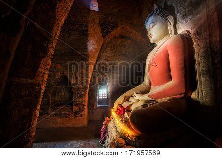 Mini Monk in meditation inside temple in Bagan Mandalay Myanmar