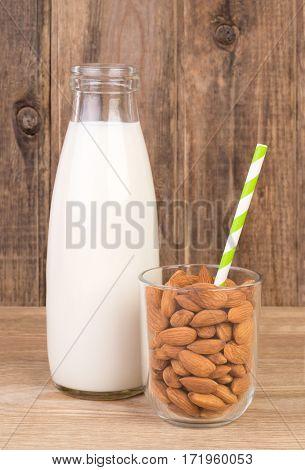 Almond milk on wooden background