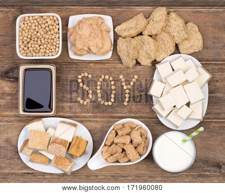 Soy products on wooden background, top view