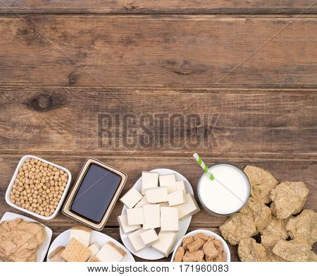 Soy products on wooden background, top view with copy space