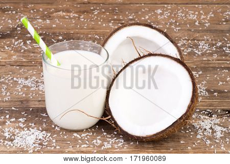 Coconut milk on wooden background