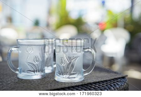 glass cups of cold water with ice. refreshments in the cafe after coffee and breakfast. Freshness every day.