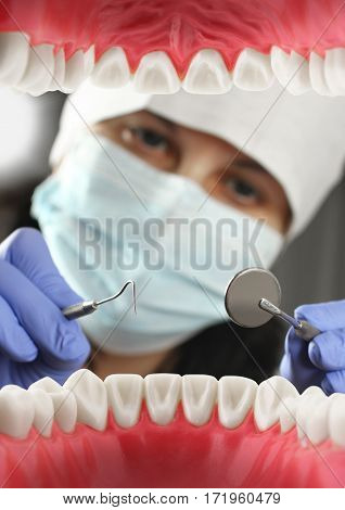 doctor treats teeth Inside mouth view. Soft focus
