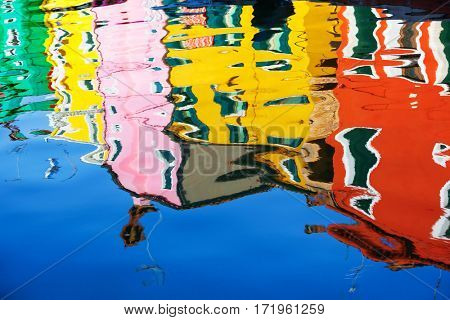 Reflection of a colorful houses in water canal, Burano island, Venice, Veneto region, Italy