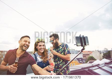 Three Happy Friends Taking Pictures Of Themselves