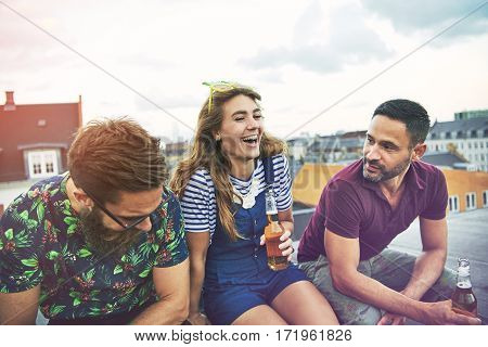 Laughing Group Of Barefoot Friends Drinking Beer