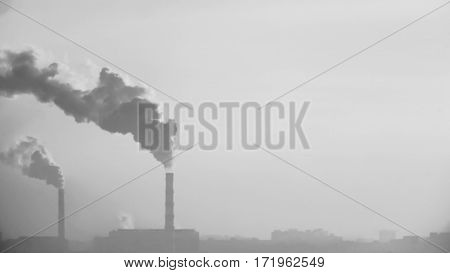 Smoke From The Chimney Of An Industrial Enterprise On A Background Of Blurred City