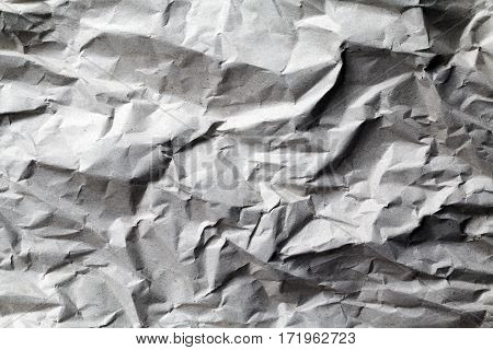 Crumpled up recycled paper texture background with shadows