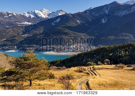 Elevated view over Savines-le-Lac Village and Serre Poncon lake in winter. Hautes-Alpes Southern Alps France