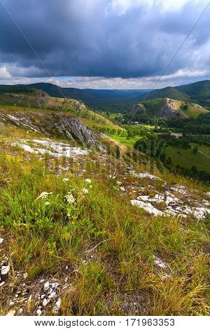 Mountain landscape with green peaks rain and gloomy skies. Russia Bashkiria.