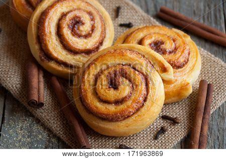 Homemade traditional swedish sweets cinnamon rolls with cinnamon sticks