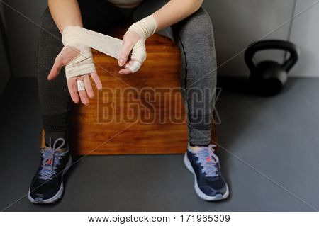 Woman Athlete Pulls Elastic Bandage.