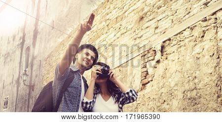 Young traveling couple: take pictures on camera. Vacation, tourism, holiday: concept