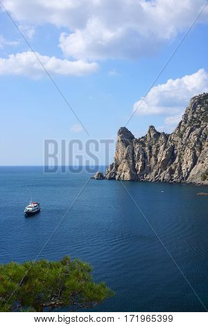 Pleasure boat in the sea bay. The village of Novy Svet. Crimea. Black Sea
