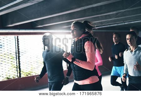 Multiracial Young Friends Enjoying An Urban Run