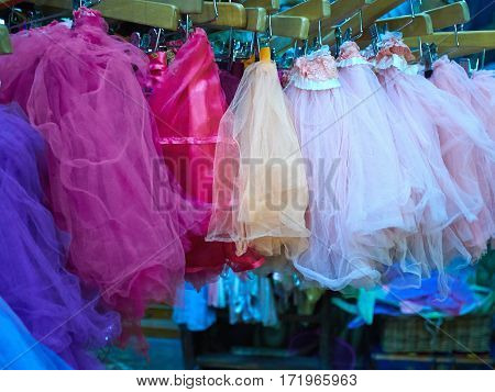 Selection of festive colorful tutu tulle skirts for girls on display