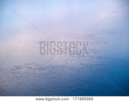 Frozen lake on a clear sunny winter afternoon nature background image