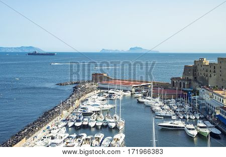 Naples Italy - June 17 2016: View of the Dell'Ovo castle over the marina