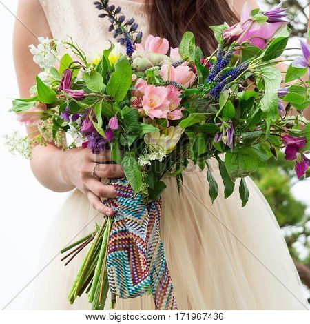 Beautiful Wedding Bouquet In The Hands Of The Bride, Bouquet Of Flowers In The Style Of Boho
