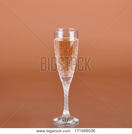 A Glass Of Champagne On A Beige Background