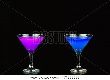 Cosmopolitan Cocktail In A Nice Purple And Blue In Front Of A Black Background