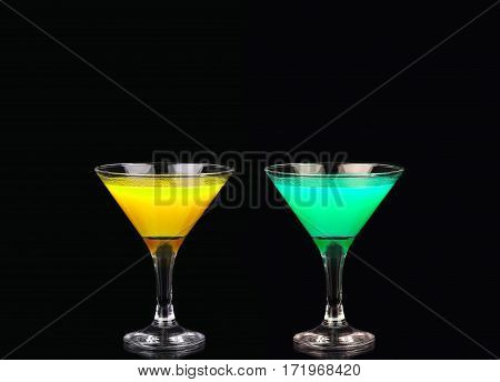 Yellow And Green Cocktail In Martini Glass Isolated On Black Background